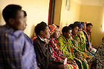 Expecting parents listening to  hygienist  Desange Mukasine speak  at Gisenyi community hospital, Rwanda...