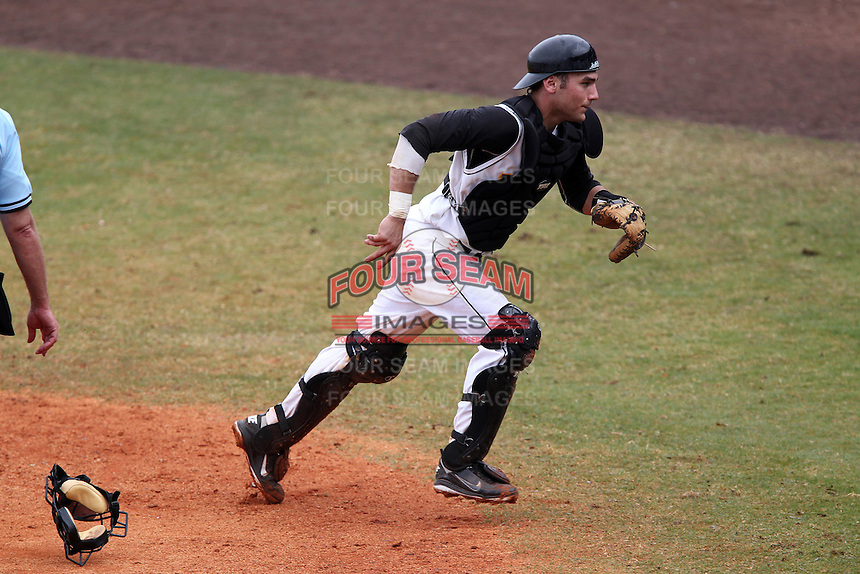 Iowa Hawkeyes catcher Keith Brand #6 chases down a passed ball during a game against the Illinois State Redbirds at Chain of Lakes Stadium on March 11, 2012 in Winter Haven, Florida.  Illinois State defeated Iowa 10-6.  (Mike Janes/Four Seam Images)