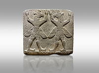 "Hittite relief sculpted orthostat stone panel of Herald's Wall Basalt, Karkamıs, (Kargamıs), Carchemish (Karkemish), 900-700 B.C. Bird-headed, winged figures of human body. Anatolian Civilisations Museum, Ankara, Turkey.<br /> <br /> These figures are called as ""Winged Griffin Demons"". Embossing is constructed symmetrically. Their hands are on their heads. It is assumed that they carry the heavens."