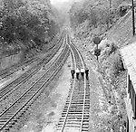 Corliss PA - View of inspectors walking the tracks near the PA Railroad station at Corliss Pennsylvania.  The assignment was for the PA Railroad due to a train derailment near the station.  Brady Stewart Studio was a contract photography studio for the railroad from 1955 through 1965.