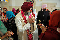 The father of the groom at the wedding ceremony of British/Punjabi couple Lindsay and Navneet Singh at a gurdwara in Amritsar.