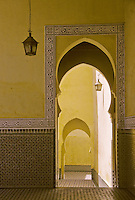"Meknes, Morocco.  Mausoleum of Moulay Ismail.  Horseshoe Arch Doorway.  The Arabic inscription in the frieze surrounding the doorway reads ""'Auzu b'illah"", ""I seek refuge in God."""