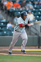 Rafael Devers (13) of the Salem Red Sox starts down the first base line against the Winston-Salem Dash at BB&T Ballpark on June 16, 2016 in Winston-Salem, North Carolina.  The Dash defeated the Red Sox 7-1.  (Brian Westerholt/Four Seam Images)