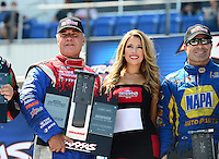 Sept. 22, 2012; Ennis, TX, USA: NHRA funny car shootout drivers (L-R) John Force, Johnny Gray, Traxxas girl and Ron Capps during qualifying for the Fall Nationals at the Texas Motorplex. Mandatory Credit: Mark J. Rebilas-