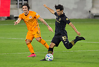 CARSON, CA - OCTOBER 28: Carlos Vela #10 of the Los Angeles FC takes a shot during a game between Houston Dynamo and Los Angeles FC at Banc of California Stadium on October 28, 2020 in Carson, California.