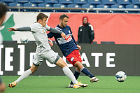 FOXBOROUGH, MA - APRIL 17: Jake Rozhansky #32 of New England Revolution II passes the ball as Victor Falck #23 of Richmond Kickers pressures during a game between Richmond Kickers and Revolution II at Gillette Stadium on April 17, 2021 in Foxborough, Massachusetts.