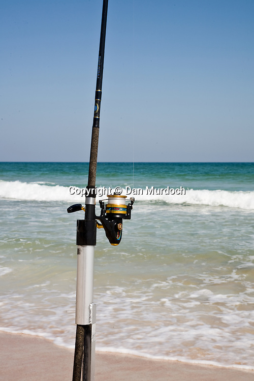 Surf fishing rod and reel on beach
