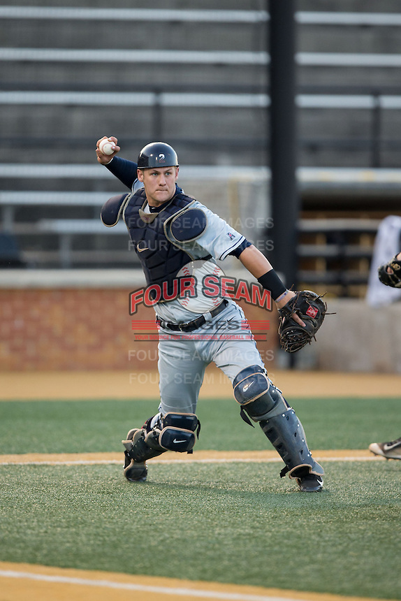 UConn Huskies catcher Max McDowell (2) makes a throw to first base against the Wake Forest Demon Deacons at Wake Forest Baseball Park on March 17, 2015 in Winston-Salem, North Carolina.  The Demon Deacons defeated the Huskies 6-2.  (Brian Westerholt/Four Seam Images)