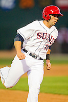 Carlos Lopez (18) of the Hagerstown Suns hustles towards third base during the game against the Delmarva Shorebirds at Municipal Stadium on April 11, 2013 in Hagerstown, Maryland.  The Shorebirds defeated the Suns 7-4 in 10 innings.  (Brian Westerholt/Four Seam Images)