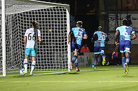 Adebayo Akinfenwa of Wycombe Wanderers (20) goes to celebrate scoring the opening goal during the The Checkatrade Trophy match between Wycombe Wanderers and West Ham United U21 at Adams Park, High Wycombe, England on 4 October 2016. Photo by David Horn.