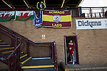 Connah's Quay Nomads 1 Llandudno 1, 20/09/2016. Deeside Stadium, Welsh Premier League. A club official securing home team's flags in the stand at the Deeside Stadium before Connah's Quay Nomads played Llandudno in a Welsh Premier League match. Both clubs represented Wales in the 2016-17 Europa League, the first time either had competed in European competition. The match ended in a 1-1 draw, watched by 181 spectators. Photo by Colin McPherson.