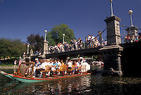 AJ4443, swan boat, Boston, Boston Public Garden, swan paddleboat, Massachusetts, Swan boat carrying passengers on the pond on a sunny day in Boston Public Garden in Boston in the state of Massachusetts. People watching from a bridge above.