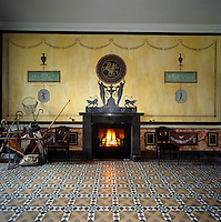 In the entrance hall of Ardgowan, decorated by Alec Cobb, the border and swags were repainted from original designs discovered under old paint