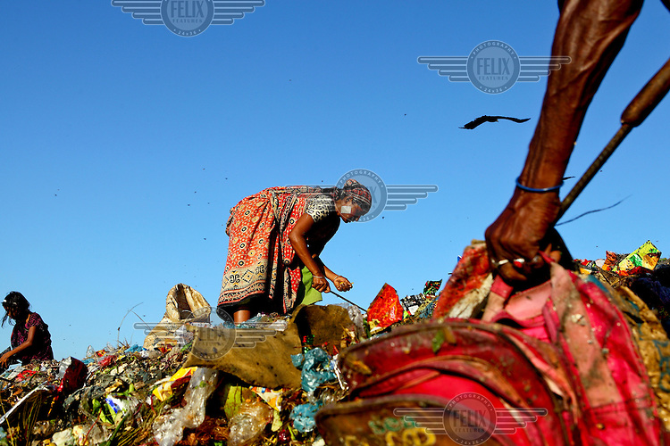Women and children look for recyclable material at the biggest rubbish dump in Dhaka. The city alone generates about 3500 to 4000 metric tons of solid waste each day.