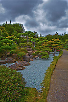 """An image of the treel-lined path through the Japanese Gardens has been """"adjusted"""", giving it a surreal look."""
