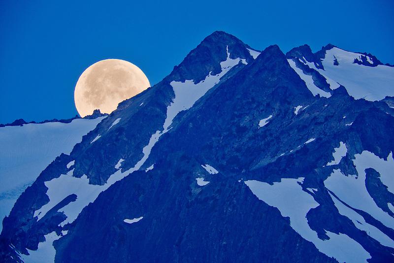 Moon set over the Olympic Mountains. Olympic National Park, Washington