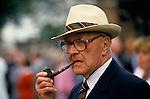 Lawn tennis association member smoking pipe at the  Wimbledon tennis championships London SW19. 1980s UK 1985