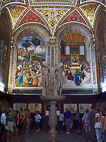 Marble sculpture and frescoes of the Piccolomini Library in the Duomo, Siena, Ital