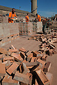 01/10/15<br /> <br /> Men check and stack some of the 18,000 bricks they are each due to move today.<br /> <br /> ***Full story here:  http://www.fstoppress.com/articles/london-bricks/  ***<br /> <br /> Triathletes have recently coined the term 'brick workout' to describe their gruelling training regime when running, following tough sessions on their bicycles.<br /> <br /> These men, 21 on every shift, each pick-up, inspect, and re-stack 18,000 London Bricks every day.<br /> <br /> One brick weighs 2 kg – so each man lifts the equivalent of almost 40 tons every day at the brick works, near Peterborough, where 2.8 million bricks are made each week.<br /> <br /> All Rights Reserved: F Stop Press Ltd. +44(0)1335 418365   www.fstoppress.com.