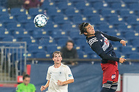 FOXBOROUGH, MA - AUGUST 5: Hikaru Fujiwara #53 of New England Revolution II heads the ball during a game between North Carolina FC and New England Revolution II at Gillette Stadium on August 5, 2021 in Foxborough, Massachusetts.