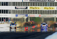 May 14, 2011; Commerce, GA, USA: NHRA funny car driver Jim Head (left) races alongside Jack Beckman during qualifying for the Southern Nationals at Atlanta Dragway. Mandatory Credit: Mark J. Rebilas-