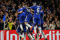 Willian of Chelsea celebrates scoring his team's second goal against Dynamo Kyiv with team mates during the UEFA Champions League Group match between Chelsea and Dynamo Kyiv at Stamford Bridge, London, England on 4 November 2015. Photo by David Horn.