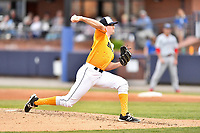 Beer City Tourists starting pitcher Brandon Gold (18) delivers a pitch during a game against the Lakewood BlueClaws at McCormick Field on June 1, 2017 in Asheville, North Carolina. The Tourists defeated the BlueClaws 8-5. (Tony Farlow/Four Seam Images)