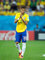 Neymar of Brazil looks like he is praying
