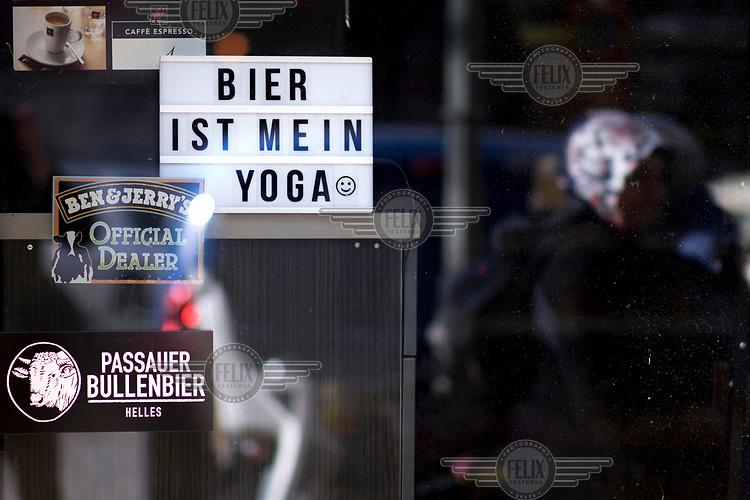 'Beer is my Yoga' a slogan displayed in a shop window.
