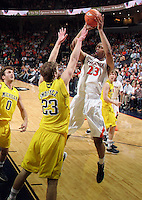 CHARLOTTESVILLE, VA- NOVEMBER 29: Mike Scott #23 of the Virginia Cavaliers shoots over Evan Smotrycz #23 of the Michigan Wolverines during the game on November 29, 2011 at the John Paul Jones Arena in Charlottesville, Virginia. Virginia defeated Michigan 70-58. (Photo by Andrew Shurtleff/Getty Images) *** Local Caption *** Mike Scott;Evan Smotrycz