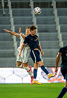 WASHINGTON, DC - SEPTEMBER 6: Maryland midfielder Nick Richardson (22) goes up for a header with Virginia forward Nick Berghold (10) during a game between University of Virginia and University of Maryland at Audi Field on September 6, 2021 in Washington, DC.