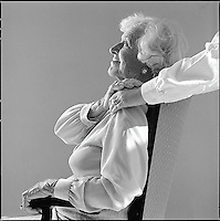Seated older woman toching arm of younger woman<br />