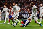 Diego Costa of Atletico de Madrid and Raphael Varane (L) and Nacho Fernandez (R) of Real Madrid during La Liga match between Atletico de Madrid and Real Madrid at Wanda Metropolitano Stadium{ in Madrid, Spain. {iptcmonthname} 28, 2019. (ALTERPHOTOS/A. Perez Meca)