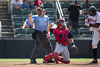 Home plate umpire Reed Basner makes a strike call during the South Atlantic League game between the Hagerstown Suns and the Kannapolis Intimidators at Kannapolis Intimidators Stadium on July 9, 2017 in Kannapolis, North Carolina.  The Intimidators defeated the Suns 3-2 in game one of a double-header.  (Brian Westerholt/Four Seam Images)