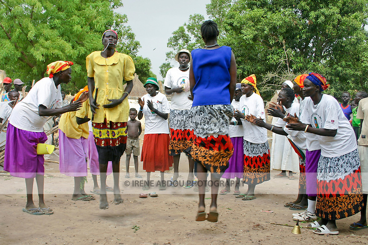 """In Rumbek, South Sudan, Dinka women perform a traditional """"jumping dance."""""""