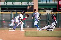 Scottsdale Scorpions shortstop Alfredo Rodriguez (3), of the Cincinnati Reds organization, covers second base as Julio Pablo Martinez (40), of the Texas Rangers organization, slides into second base on an attempted steal during an Arizona Fall League game against the Surprise Saguaros at Scottsdale Stadium on October 26, 2018 in Scottsdale, Arizona. Surprise defeated Scottsdale 3-1. (Zachary Lucy/Four Seam Images)