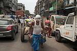 Daily wage laborers pull a hand cart full of goods at burrabazzar in Kolkata.  Whole sale market reopened in Kolkata few days back midst 21 days lock down in India due to covid 19 pandemic. Kolkata, West Bengal, India. Arindam Mukherjee.