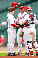 Houston Cougars pitching coach Jack Cressend has a talk with Codey Morehouse #5 and John Cannon #37 during the game against the Baylor Bears at Minute Maid Park on March 4, 2011 in Houston, Texas.  Photo by Brian Westerholt / Four Seam Images