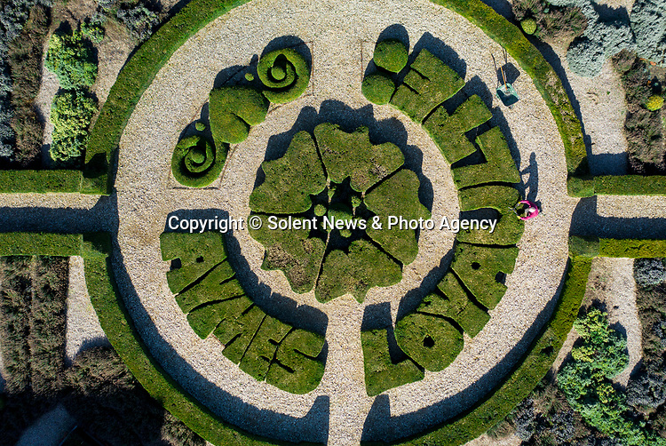 Gardener Chris Budd tends to the spectacular arrangement of flowers in the Knot Garden, sat amongst the grounds once used as a formal garden for Tudor royalty at Basing House in Basingstoke, Hampshire, with the Paulet family motto shaped into the topiary trees which translates to 'Love Loyalty'. 