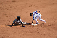 Peoria Javelinas left fielder Buddy Reed (85), of the San Diego Padres organization, slides safely into second base ahead of the tag by Nico Hoerner (17) during an Arizona Fall League game against the Mesa Solar Sox at Sloan Park on October 24, 2018 in Mesa, Arizona. Mesa defeated Peoria 4-3. (Zachary Lucy/Four Seam Images)