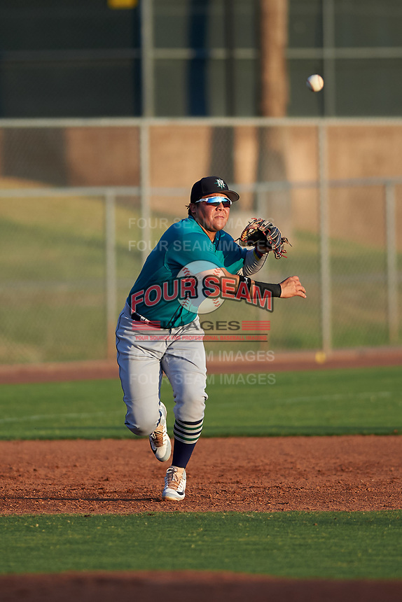 AZL Mariners third baseman Nolan Perez (5) throws to first base during an Arizona League game against the AZL Giants Orange on July 18, 2019 at the Giants Baseball Complex in Scottsdale, Arizona. The AZL Giants Orange defeated the AZL Mariners 7-4. (Zachary Lucy/Four Seam Images)