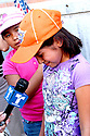 AJ Alexander -  Katharine Figueroa crying in an interview at the Children March in protest against Sheriff Joe Arpaio arressting Illeagal undocumented workers in this  county. From the county jail on 4th ave to Wells Fargo Bank on Friday August 7, 2009.  Photo by AJ Alexander