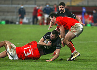 12 December 2020; Aaron Sexton of Ulster is tackled by Dan Goggin of Munster during the A series inter-pros series 20-21 between Ulster A and Munster A at Kingspan Stadium, Ravenhill Park, Belfast, Northern Ireland. Photo by John Dickson/Dicksondigital