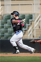 Zach Fish (24) of the Kannapolis Intimidators follows through on his swing against the Lakewood BlueClaws at Kannapolis Intimidators Stadium on May 8, 2016 in Kannapolis, North Carolina.  The Intimidators defeated the BlueClaws 3-2.  (Brian Westerholt/Four Seam Images)