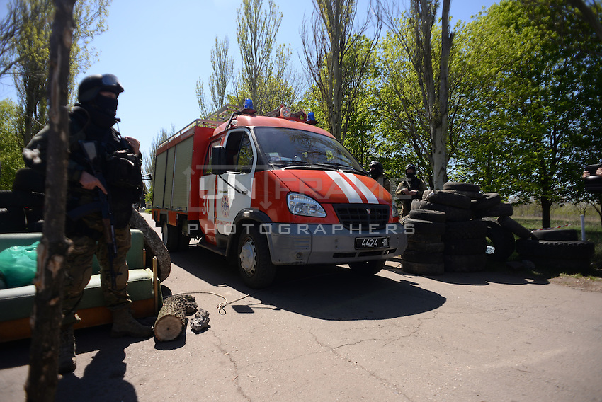 Ukrainian security service forces protect airport of Kramatorsk after the sabotage of Mi8 helicopter by pro-russian activists