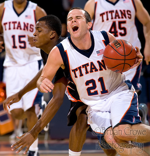 12/30/10, Fullerton Ca.; CSUF wins a close one over Pacific on Devon Peltier's 3 with .4 seconds left.