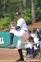 Charleston RiverDogs pitcher Rookie Davis #34 warms up in the bullpen prior to the game against the Greenville Drive at Joseph P. Riley Jr. Ballpark  on April 9, 2014 in Charleston, South Carolina. Greenville defeated Charleston 6-3. (Robert Gurganus/Four Seam Images)