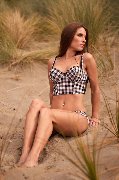 Lexxie Robinson on the beach in chequered lingerie.