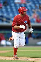 Clearwater Threshers designated hitter Willians Astudillo (4) runs to first during a game against the Tampa Yankees on April 21, 2015 at Bright House Field in Clearwater, Florida.  Clearwater defeated Tampa 3-0.  (Mike Janes/Four Seam Images)