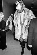 Manhattan, New York City, NY - March 8, 1971  <br /> Muhammad Ali and Joe Frazier at Madison Square Garden.<br /> Billed as the 'Fight of the Century' African-American boxing fans and dandies attended wearing the most glam-fashions of the day. Furs, minis and thigh-high platform boots were all the rage.